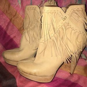 High fringe, high heeled ankle boots